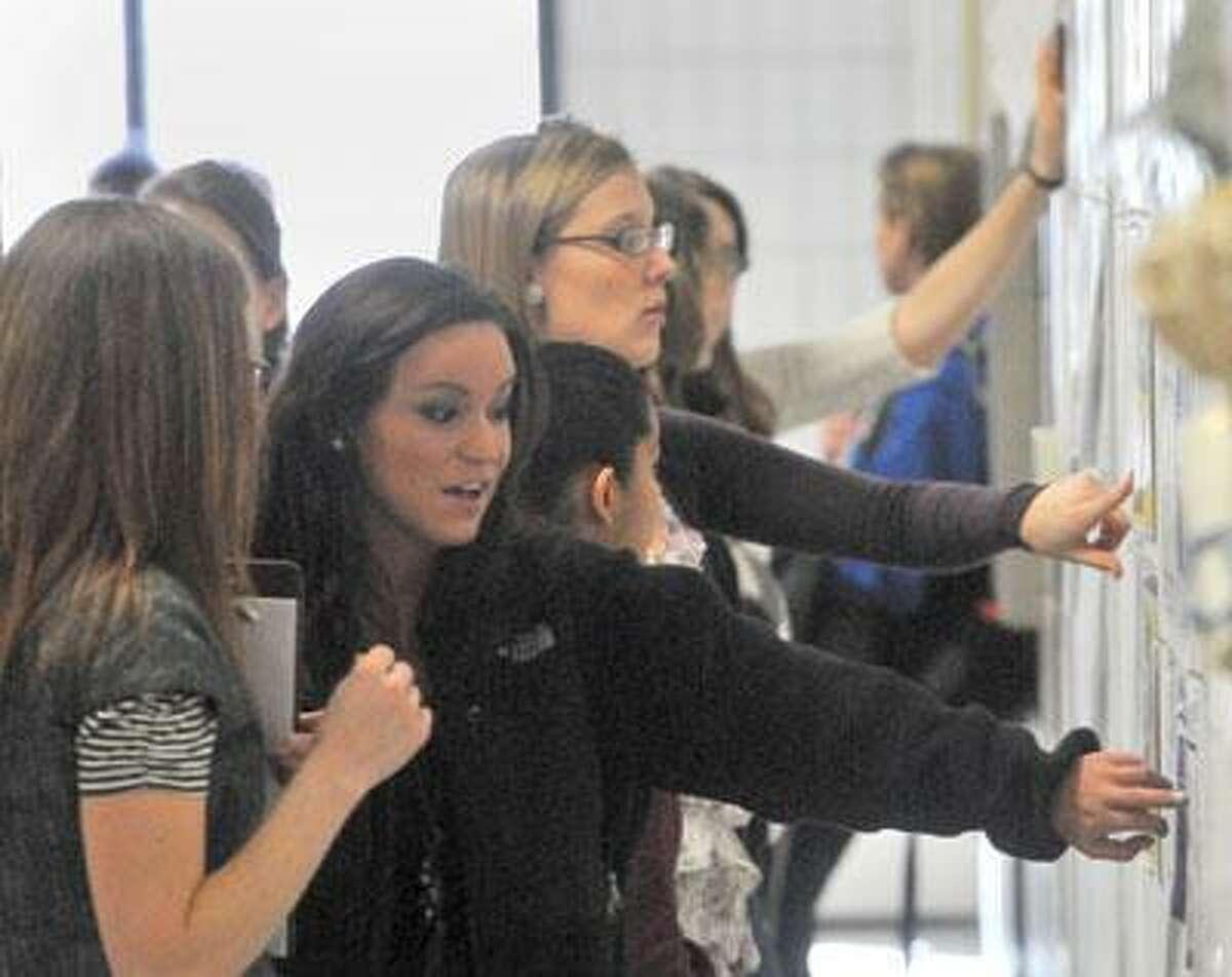 Interior Design 4 students critique one another's work in Robert B. Dodd's Hall. (Brad Horrigan/Register)
