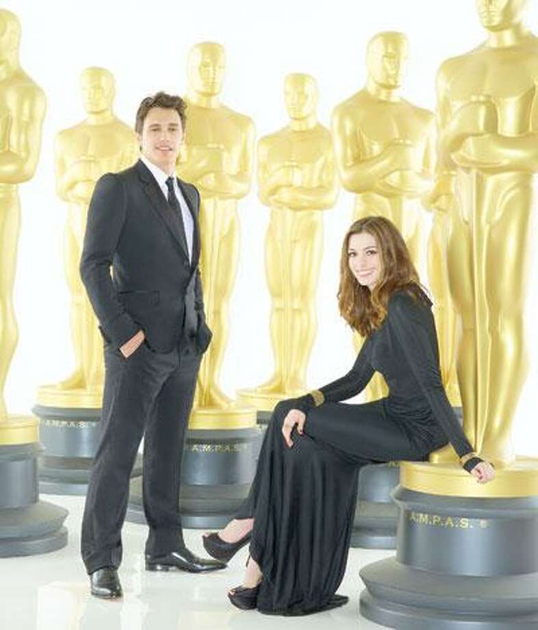 """Oscar co-hosts James Franco, who spends some time in New Haven these days, and Anne Hathaway, who, if she could stand up to Meryl Streep (""""The Devil Wears Prada"""") should be able to handle this job. (ABC)"""