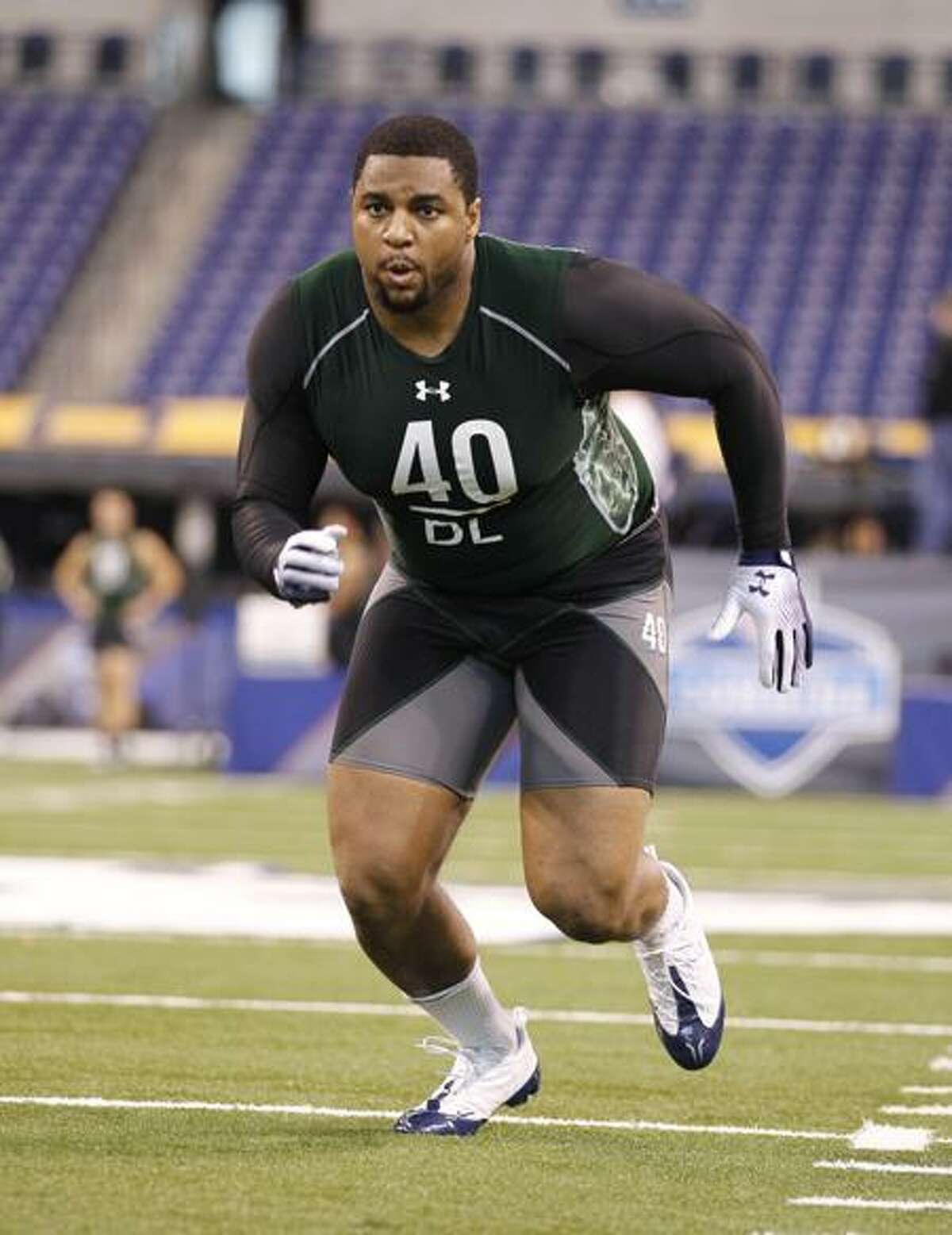 Richmond defensive lineman Martin Parker runs a drill at the NFL football scouting combine in Indianapolis in February.