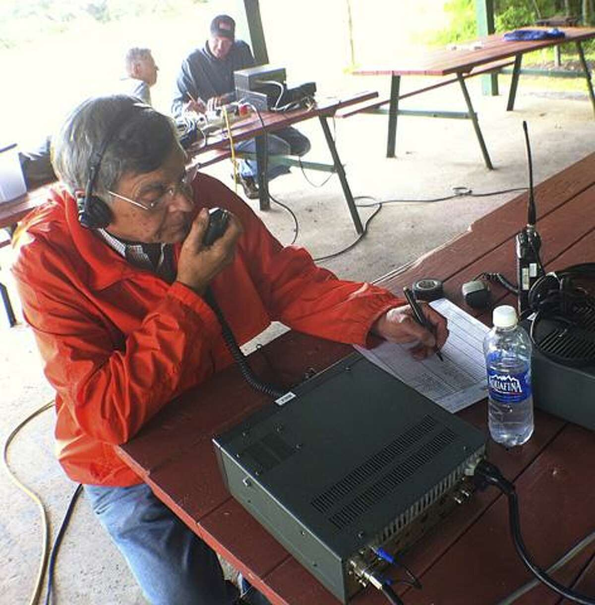 Dispatch Staff Photo by JOHN HAEGERRolfe Ferrara along with fellow Madison-Oneida Amateur Radio Club members work to make contacts during the annual Field Day event sponsored by the American Radio Relay League on Saturday, June 25, 2011 at Oxbow Park.