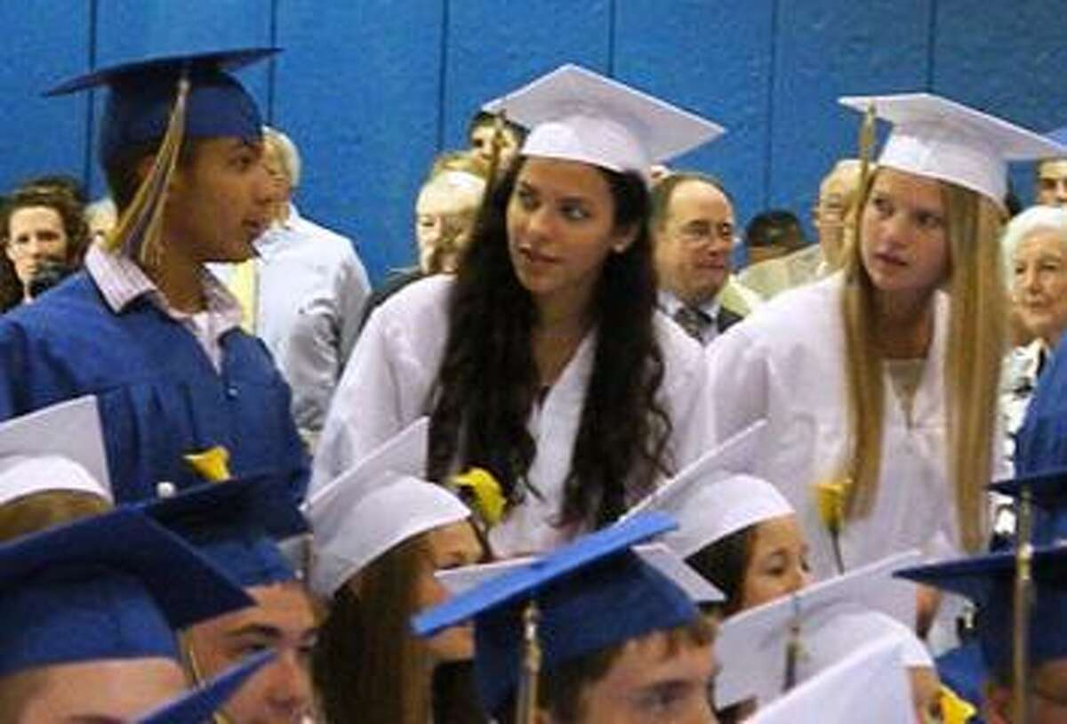 Photo Special to the Dispatch by MIKE YEOMAN Cazenovia graduates enter the Cazenovia College Athletic Center for the 80Th Commencement Saturday.