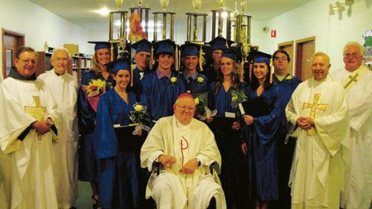 Photo Courtesy HOLY CROSS ACADEMY Bishop James Moynihan, center and the Holy Cross Academy Class of 2011. They are flanked from left by the Rev. Reynald Yudin, OFM; Msgr. Matthew Luczycki; Fr. Richard Kapral; and Deacon James Chappell.