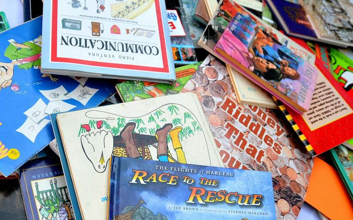 Books donated by New Haven reads were offered to kids at the event. Brad Horrigan/Register