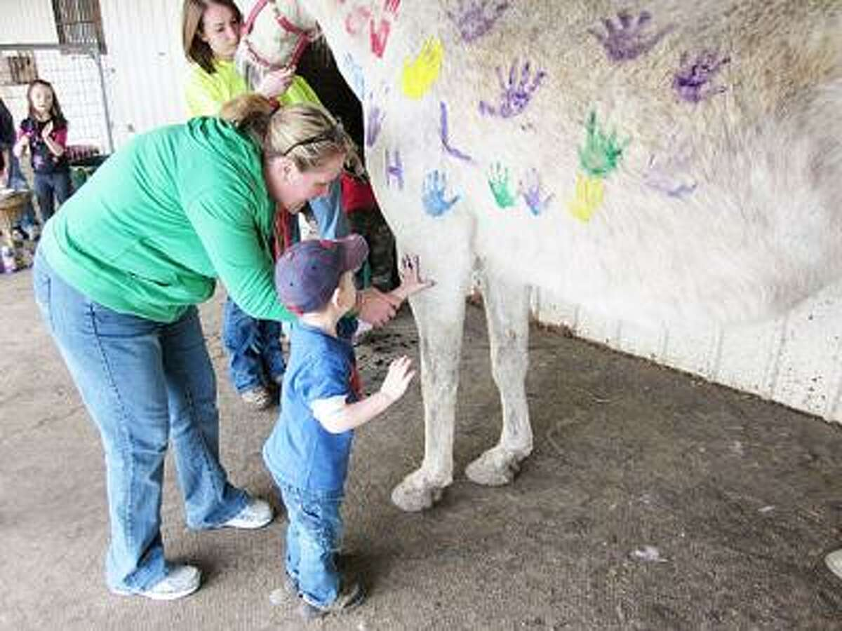 Photo Courtesy ROOT FARM Children hand paint a horse at the Root Farm's annual Fun at the Farm open house.
