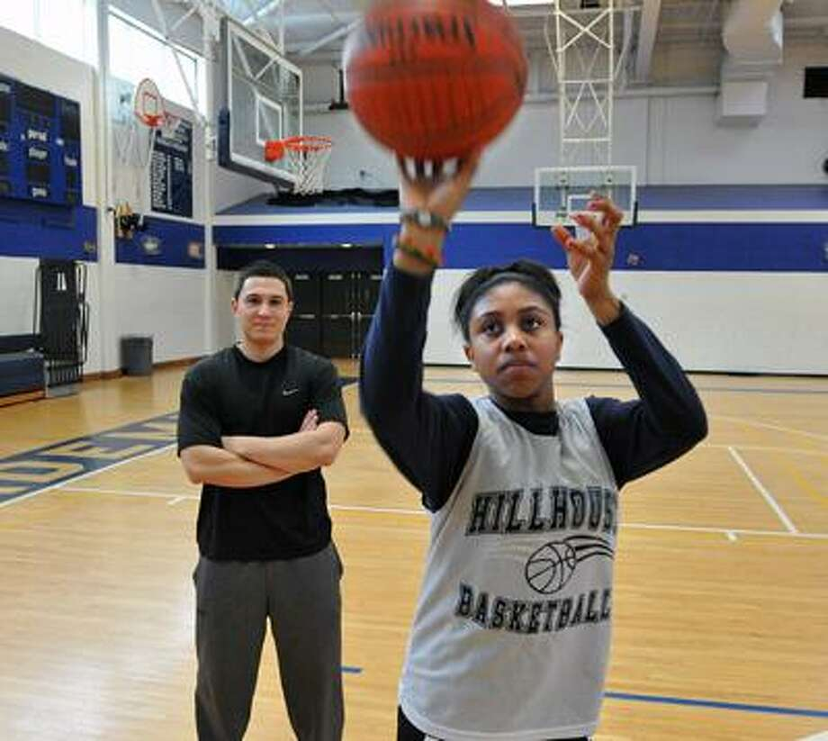 New Haven-- Hillhouse standout basketball player Andreanna Thomas takes a shot during a game of HORSE with Register writer Chris Hunn. Photo by Peter Casolino/New Haven Register02/24/11 Cas11024