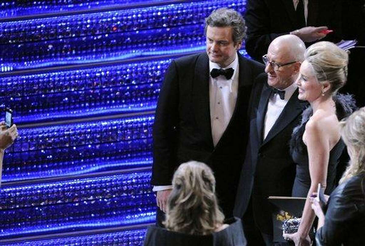 From left, actors Colin Firth, Geoffrey Rush, and Sharon Stone are seen during the 83rd Academy Awards on Sunday, Feb. 27, 2011, in the Hollywood section of Los Angeles. (AP Photo/Mark J. Terrill)