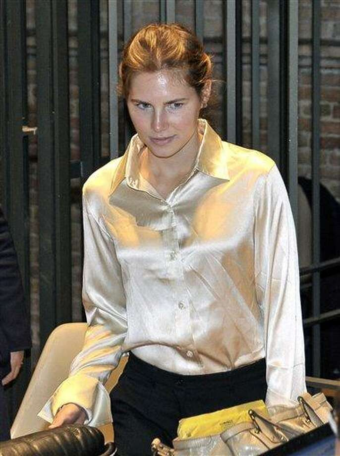 In this Saturday, May 21, 2011 file photo, Amanda Knox arrives at the Perugia court, Italy, Saturday, May 21, 2011. American student Amanda Knox's appeals trial resumes Monday, June 27, 2011, with testimony from an Ivorian man also convicted in the slaying of Knox's roommate in Perugia. Rudy Hermann Guede is serving a 16-year-prison sentence for the 2007 murder of Meredith Kercher, a British student who was stabbed to death in the apartment she shared with Knox. (AP Photo/Stefano Medici, File) Photo: AP  / AP