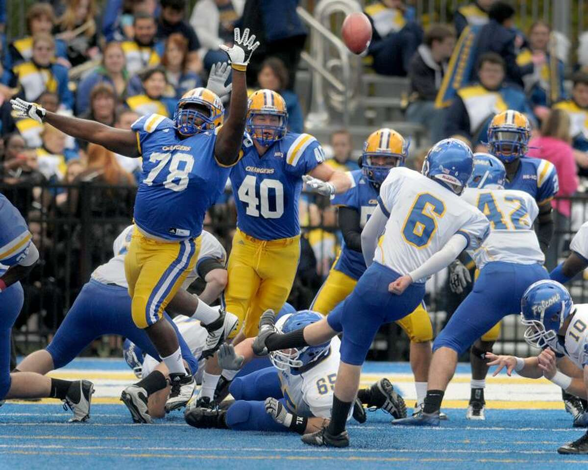 Defensive tackle Raheem Stanley of the University of New Haven # 78, left, blocks an extra point by place kicker Will Lockwood of Bentley College during first quarter football action Saturday 10/22/11 at the University of New Haven. Photo by Peter Hvizdak / NewHaven RegisterOctober 22, 2011 ph2391 Connecticut