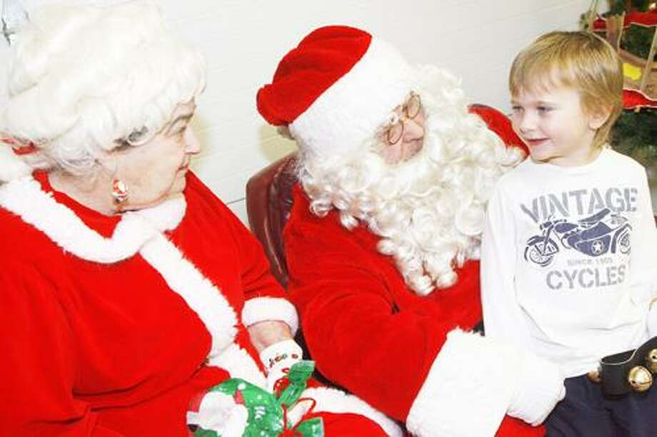 Dispatch Staff Photo by JOHN HAEGER (Twitter.com/OneidaPhoto) Cody Klahs, 4, of Vernon, asks Santa and Mrs. Claus for a red bike and helmet during the third annual Village of Vernon Holiday Party on Saturday, Dec. 17, 2011 in Vernon.