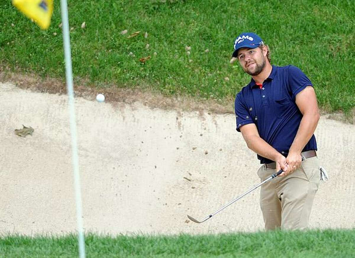 Cromwell--Ryan Moore reacts as he nearly makes the bunker shot on 18 for a birdie. After a 2-putt, he ended up with a Bogie. . Photo-Peter Casolino/New Haven RegisterCas110626 6/26/11