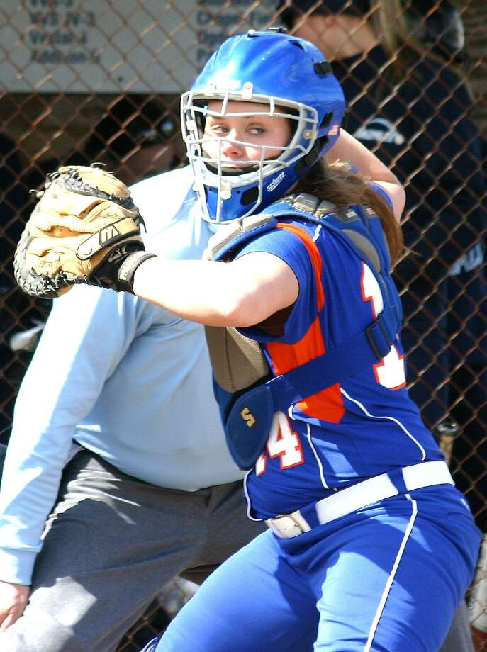 Submitted Photo by JON RATHBUN Oneida catcher Shannon Dowling makes a throw at the Mudville tournament in Herkimer Friday, April 22, 2011. Oneida was beat 6-0 by Elmira Notre Dame and Molloy.