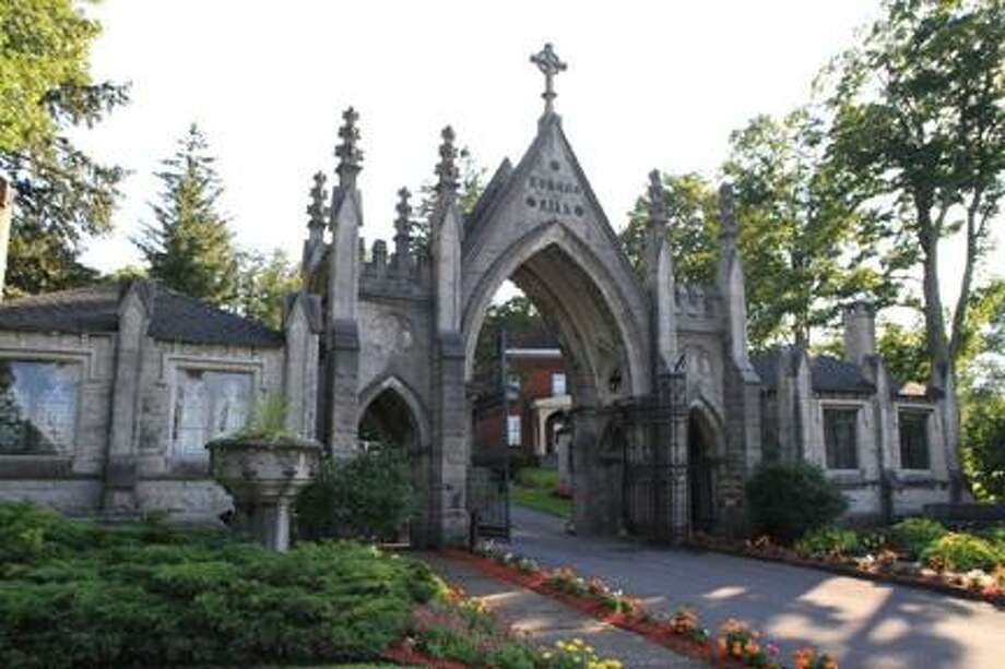 Submitted Photo The front gate of the Forest Hill Cemetery is a longtime city landmark. Stewart Williams will describe some of Utica's better known funerals during his August 22 talk.