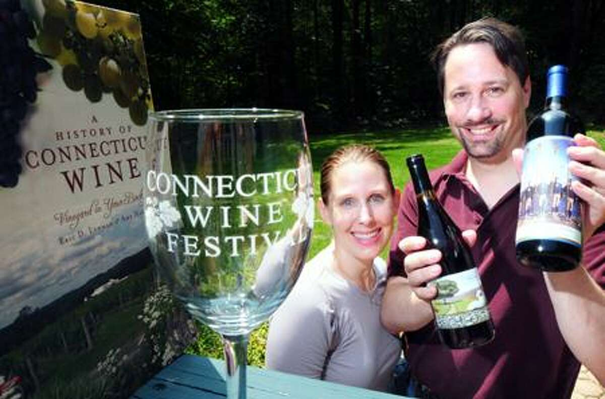Amy Nawrocki (center) and her husband, Eric Lehman (right) are photographed with their book, A History of Connecticut Wine, at their home in Hamden on 6/21/2011.Photo by Arnold Gold/New Haven Register AG0416A