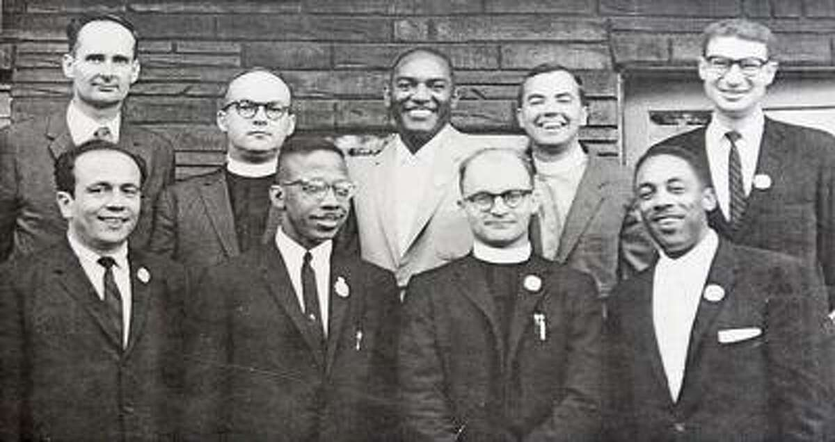"""Southington--Retired Pastor Ralph Lord Roy, second from the right, in front row along with other """"Freedom Riders"""" during the 60's. Photo by Peter Casolino/New Haven Register02/18/11 Cas110218"""
