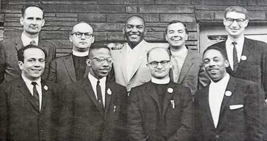 "Southington--Retired Pastor Ralph Lord Roy, second from the right, in front row along with other  ""Freedom Riders"" during the 60's. Photo by Peter Casolino/New Haven Register02/18/11 Cas110218"