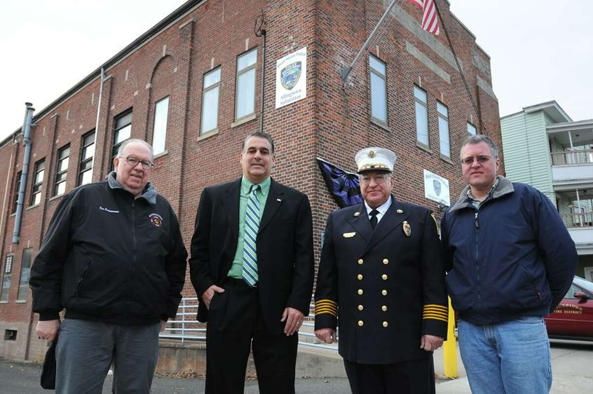 The Allingtown fire district has been at the center of debate in West Haven for many years. Shown outside the Allingtown fire house are, from left: Fire Commissioner Bob Lathrop, Mayor John Picard, Allingtown Chief Peter Massaro and Commission chairman Ron Walters. Peter Casolino/New Haven Register