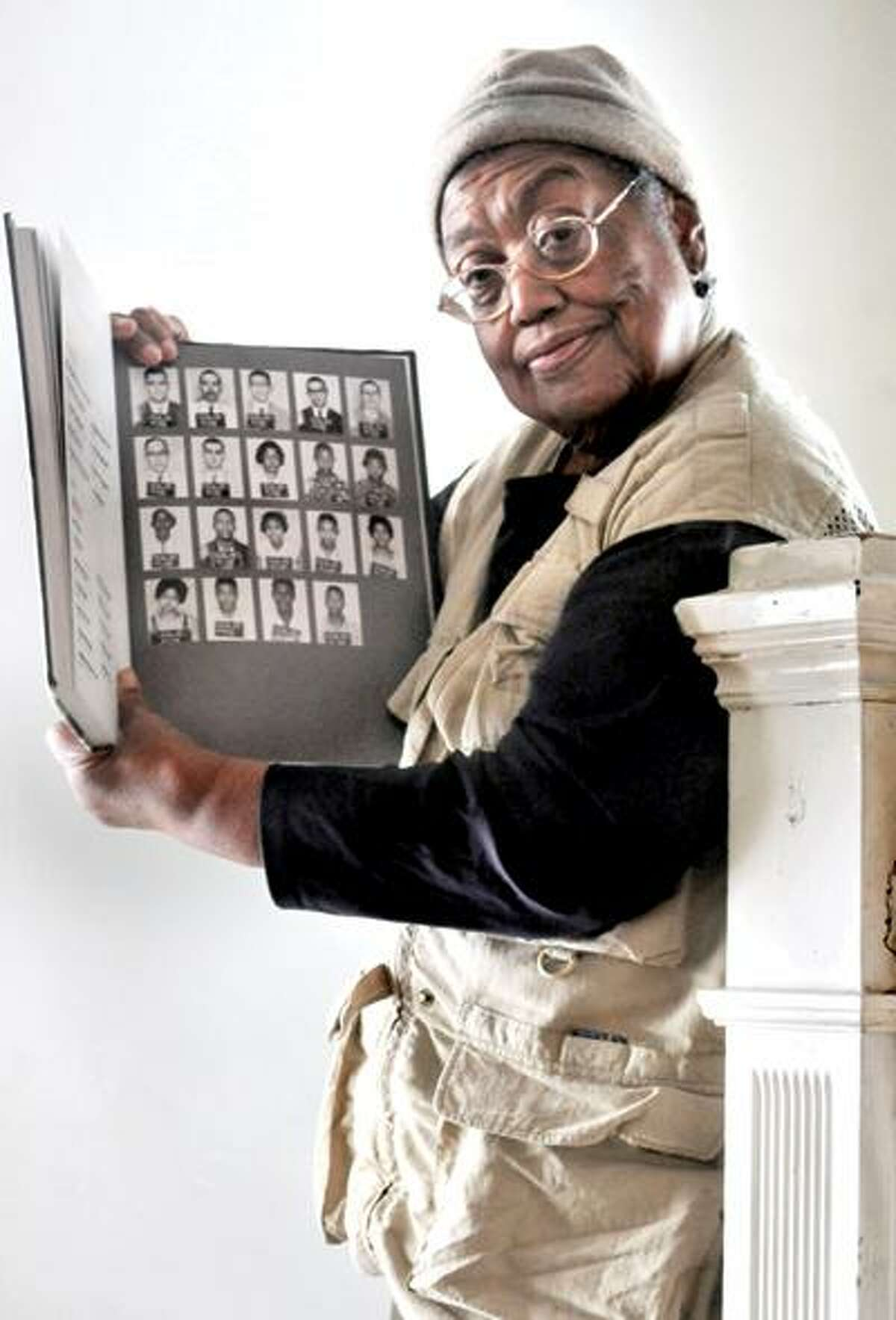 Melanie Stengel/Register photo: Retired New Haven history teacher Lula White, who now lives in Hamden, shows the mug shots of Freedom Riders, including one of herself. White spent time in the Mississippi State Penitentiary, also known as Parchman Farm, for her role in the protest.