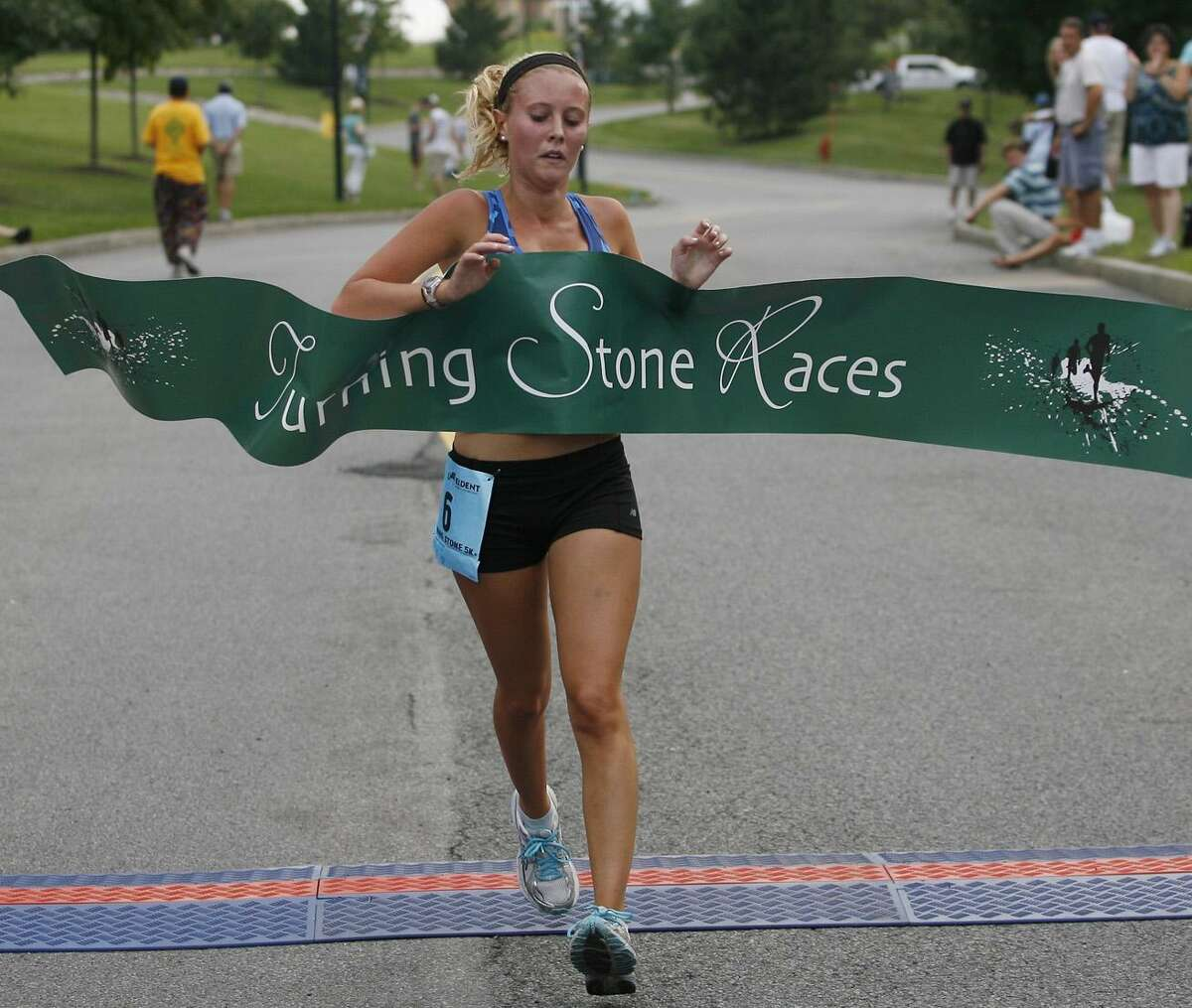 Dispatch Staff Photo by JOHN HAEGERtwitter.com/oneidaphotoMeaghan Anklin crosses the finish line to win the inaugural 5K race at Turning Stone on Friday, Aug. 19, 2011.