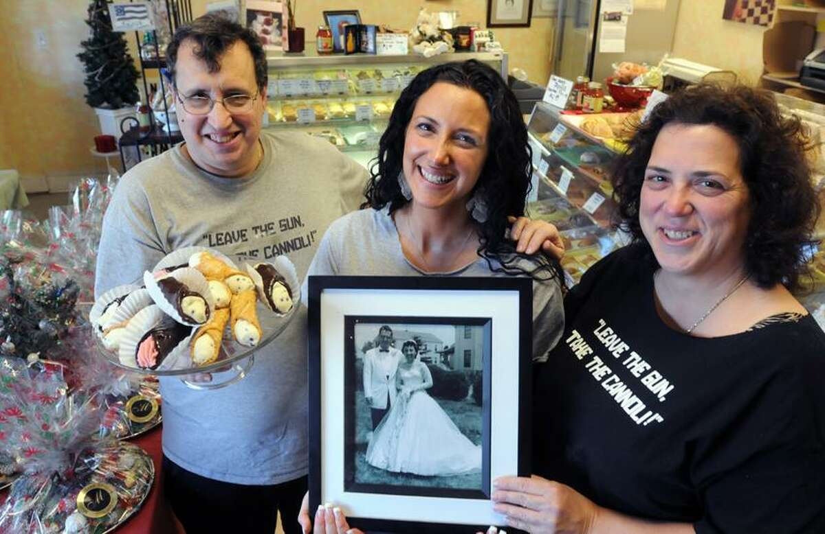 The Meriano Bake Shoppe siblings, Anthony Meriano III, left, Andrea Meriano Fanelli, center, and Liz Meriano have, in honor of their parents, Elizabeth and Anthony, been raising funds by selling T-shirts for cancer research conducted by Dr. Dan Boffa at the Smilow Cancer Hospital at Yale-New Haven. Photo by Mara Lavitt/New Haven Register