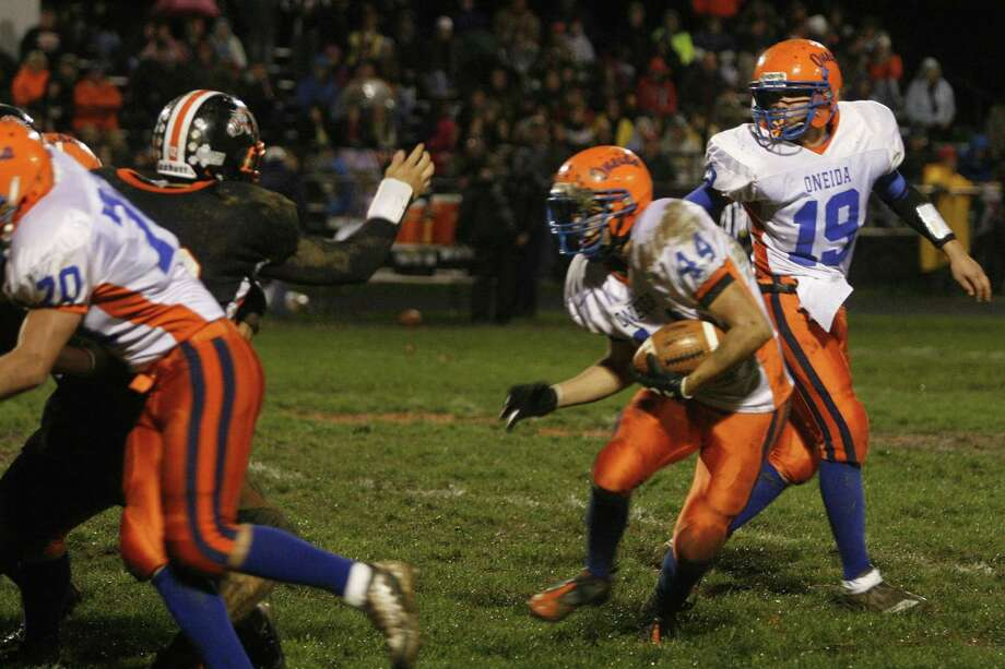 "Dispatch Staff Photo by JOHN HAEGER <a href=""http://twitter.com/oneidaphoto"">twitter.com/oneidaphoto</a> Oneida's Dylan Cafalone (44) Looks for room to run after taking the handoff from Tyler Mallinder (19)  in the first half of the Sec III playoff match in Mexico Friday, Oct. 21, 2011."