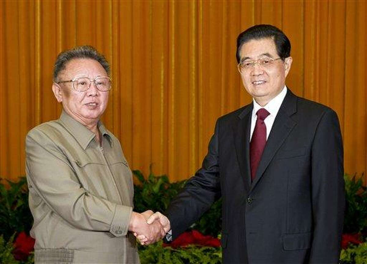 n this May 25, 2011, file photo released by China's Xinhua news agency, North Korean leader Kim Jong Il, left, shakes hands with Chinese President Hu Jintao during a meeting in Beijing. North Korean state media announced Kim's death today. Associated Press