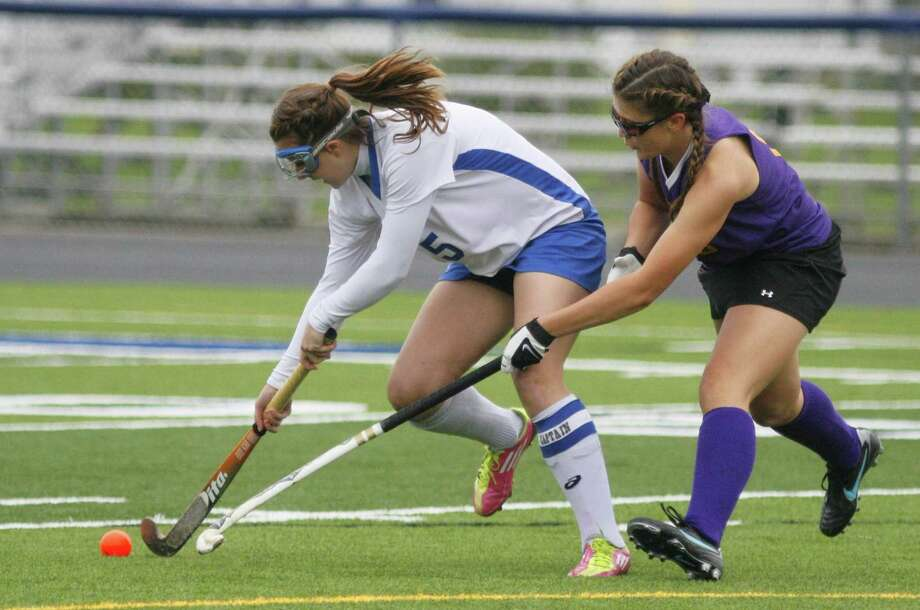 "Dispatch Staff Photo by JOHN HAEGER <a href=""http://twitter.com/oneidaphoto"">twitter.com/oneidaphoto</a> Camden's Kianne Hinkle (5) controls the ball as Holland Patent's Julia Hayes (13) reaches into defend in the first half of the match in Camden on Friday, Oct. 21, 2011."