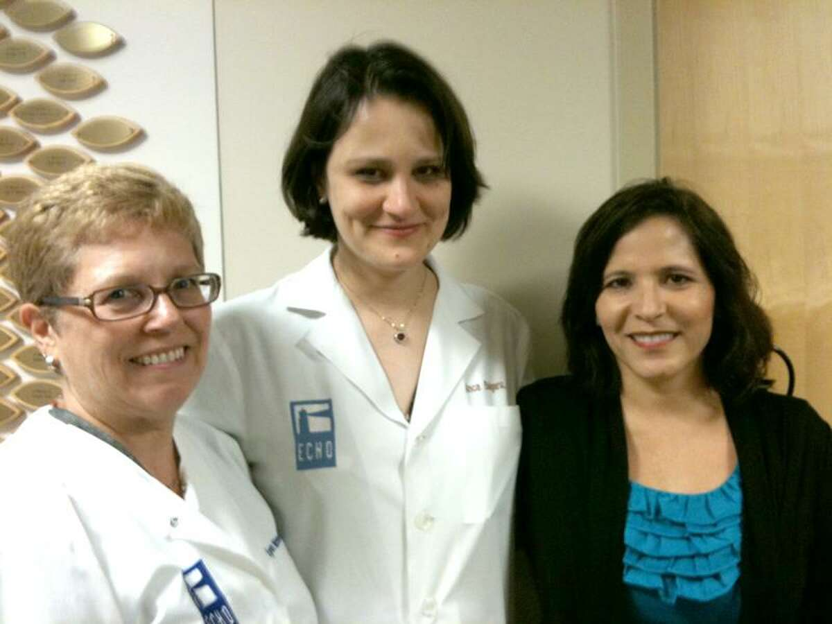 Ann DeMatteo/Register photo: Nurse Lynn Mortoro, left, Dr. Anca Bulgaru and former patient Rose Gerber at the Eastern Connecticut Hematology Oncology office at Backus Hospital in Norwich.