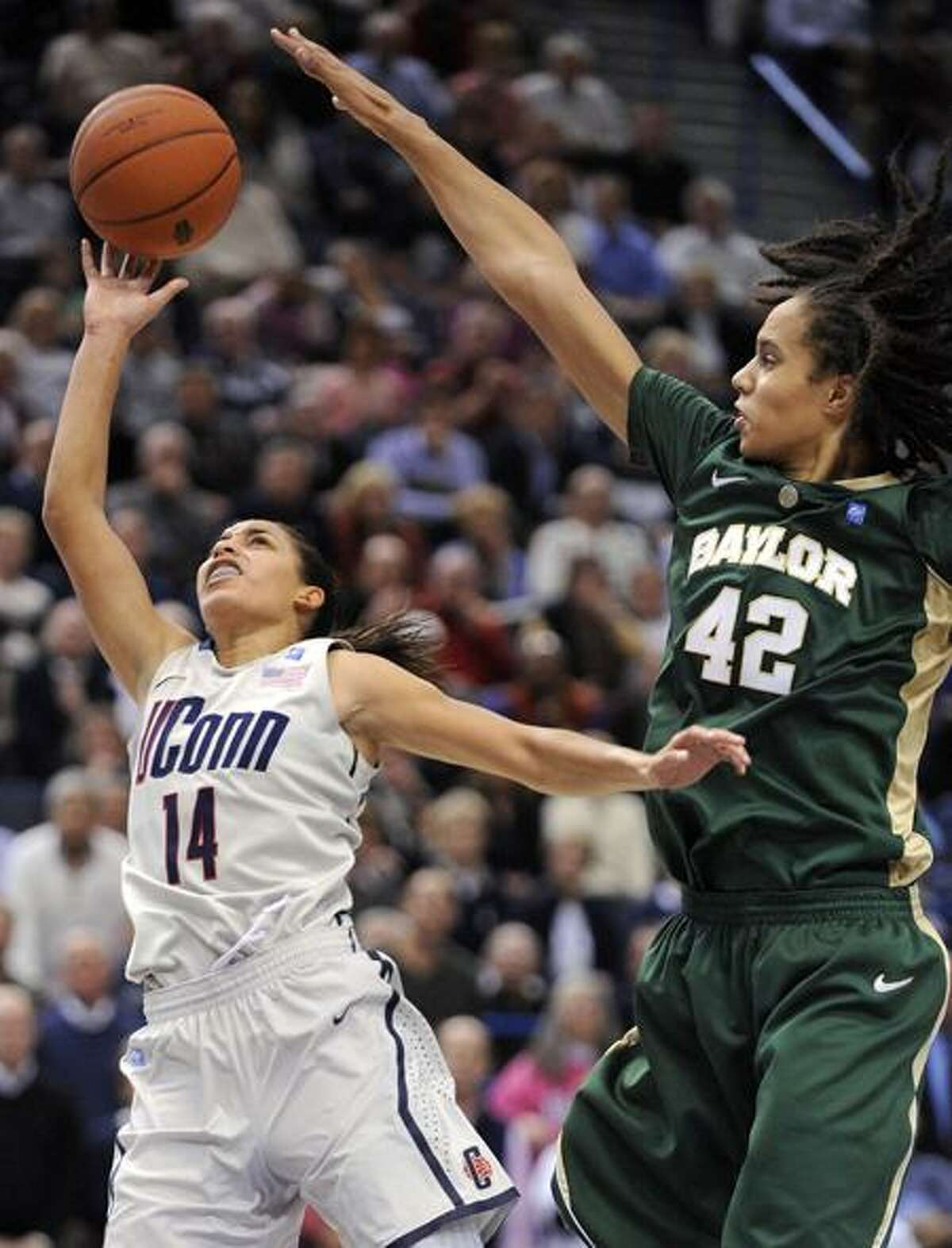 Baylor's Brittney Griner, right, defends on a shot by Connecticut's Bria Hartley during the second half of Connecticut's 65-64 victory in an NCAA college basketball game in Hartford, Conn., on Tuesday, Nov. 16, 2010. Griner scored 19 points, had seven rebounds and nine blocked shots. (AP Photo/Fred Beckham)