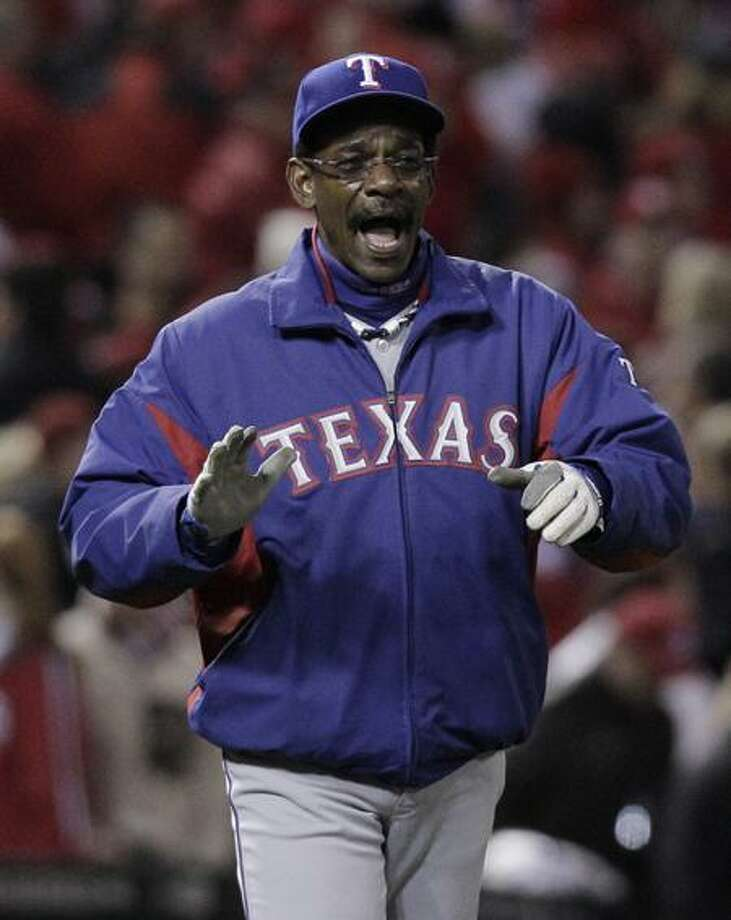 Manager Ron Washington and the Rangers are happy to be back in Texas with the World Series tied at 1-1. (AP Photo) Photo: AP / AP2011