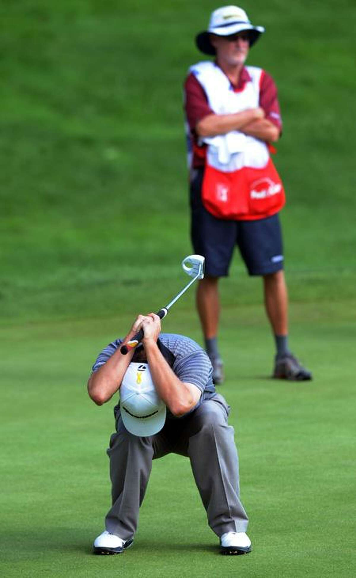 Spencer Levin reacts to missing a birdie putt on the 18th green at the Travelers Championship on Saturday. (Melanie Stengel/Register)