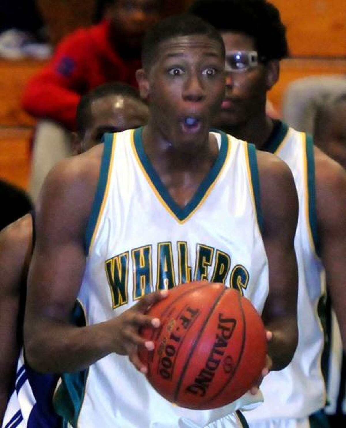 37th annual Doc Hurley Scholarship Basketball Classic, Weaver HS, Hartford. New London's Kris Dunn reacts to a traveling call on him. Photo by Mara Lavitt/New Haven Register12/17/11