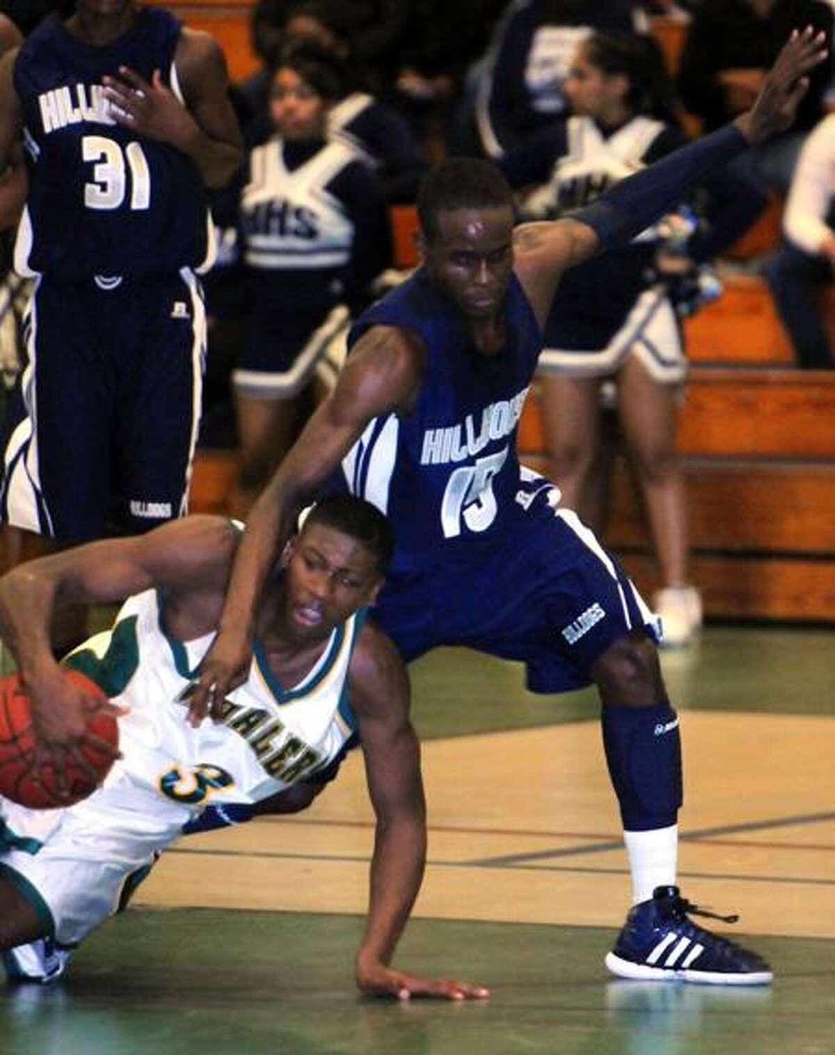 37th annual Doc Hurley Scholarship Basketball Classic, Weaver HS, Hartford. New London's Kris Dunn left and Hillhouse's Richard Bronson right. Photo by Mara Lavitt/New Haven Register12/17/11