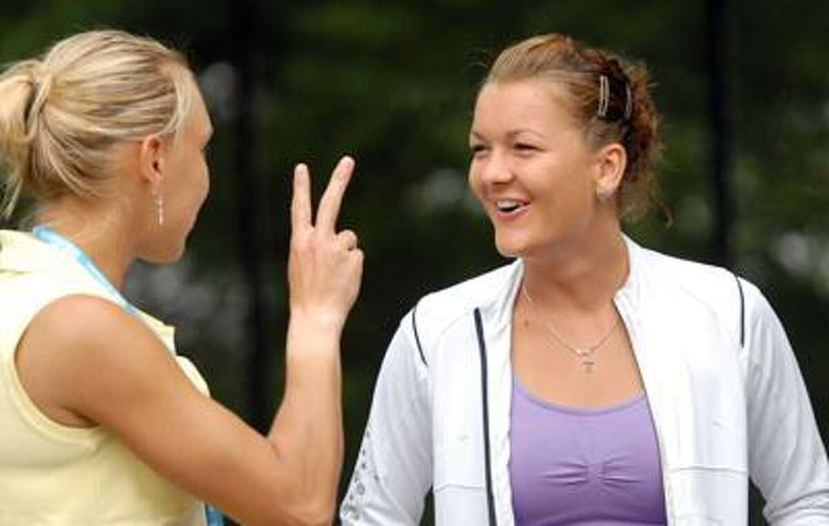 Elena Vesnina, left, and Agnieszka Radwanska, right, both WTA players at the New Haven Open, chat together before the Main Draw announcements Friday 8/19/11 at the Connecticut Tennis Center in New Haven Photo by Peter Hvizdak / New Haven Register August 19, 2011 ph2344 Connecticut