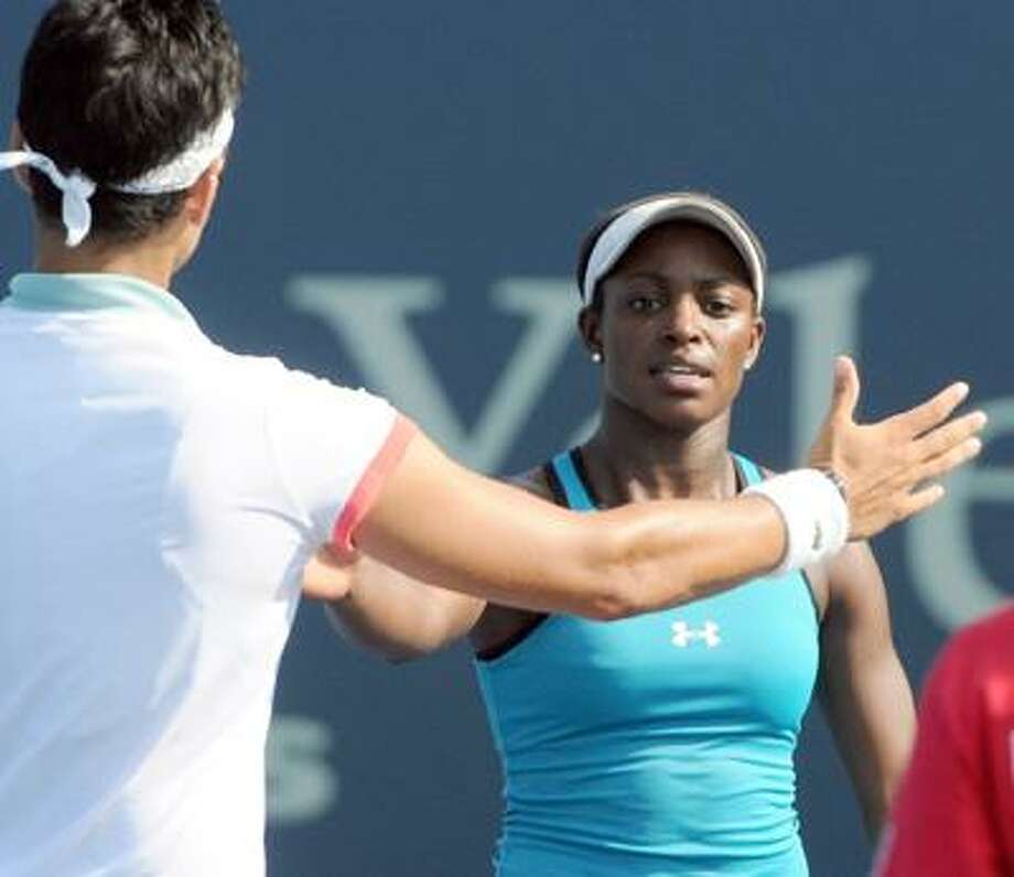 Sloane Stephens of the U.S.A, right,  shakes hands with Eleni DANIILIDOU of Greece after defeating her on the Grandstand Court during the Womens Tennis Association New Haven Open Friday 8/19/11 at the Connecticut Tennis Center in New Haven. Photo by Peter Hvizdak / New Haven Registerdate      ph2283       Connecticut Photo: Peter Hvizdak/New Haven Register / ©Peter Hvizdak / New Haven Register