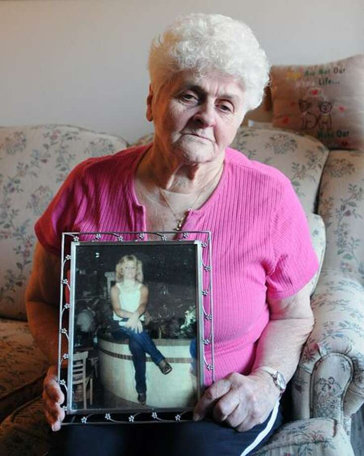 Janet Frisco holds a photo of her daughter, Evelyn Ann Frisco, who has been missing since 2004. Peter Casolino/Register