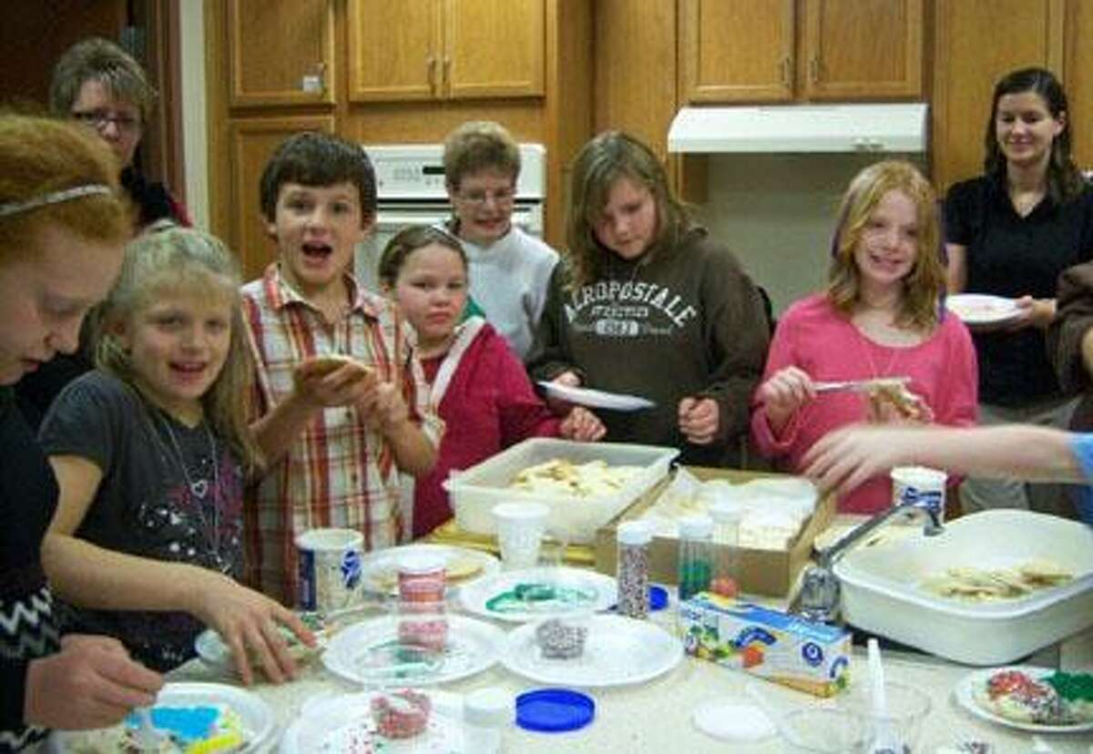 Photo Courtesy Community Action Partnership Mentees Jeanna Pittman of Morrisville, Emily Smith of Canastota, Jeremy Domena of Canastota, Serenity Ali of Canastota, Ciara Runice of Oneida and Connie Grimsley of Oneida are seen decorating cookies in the front row while mentors Carla Fitzgerald of Oneida, Pat Jordan of Verona, and Beth Colvin of Canastota enjoy watching the fun from the back row.