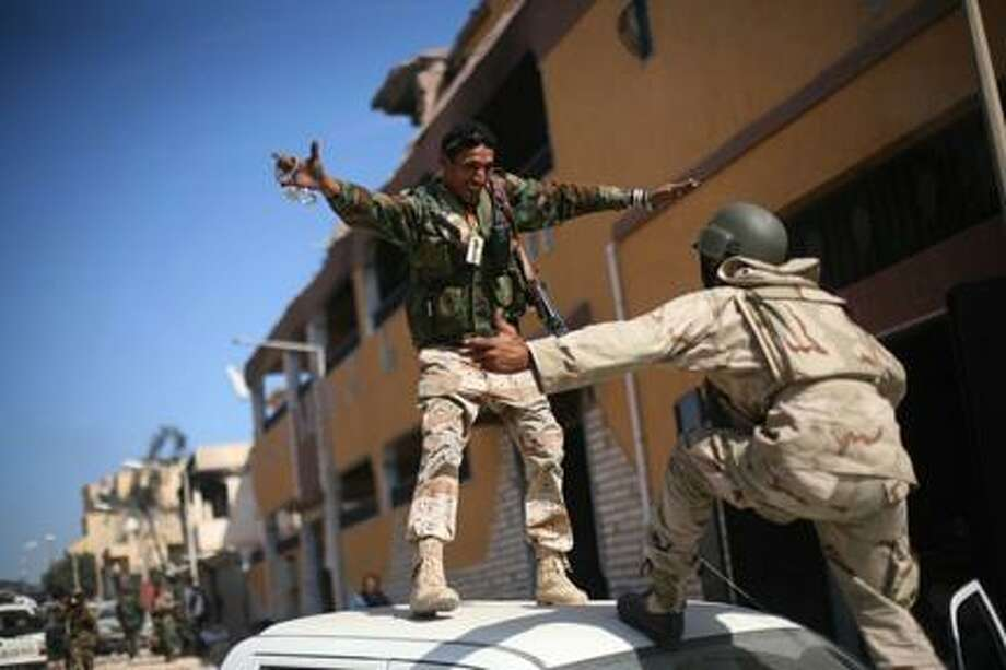 AP PhotoRevolutionary fighters celebrate the capture of Sirte, Libya, Thursday, Oct. 20, 2011. Photo: ASSOCIATED PRESS / AP2011