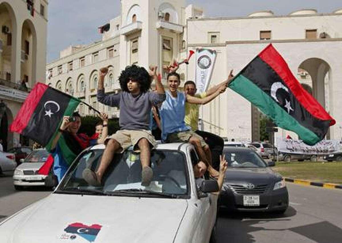 AP PhotoLibyans celebrate Moammar Gadhafi's death in Tripoli, Libya, Thursday, Oct. 20, 2011.