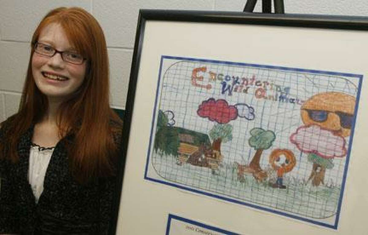 Dispatch Staff Photo by JOHN HAEGER (Twitter.com/OneidaPhoto)J.D. George Elementary School 6th grader Alexis Schaub, 11, poses with her first place poster she created for Conservation Education Day on Friday, Dec. 16, 2011 at the school in Verona.