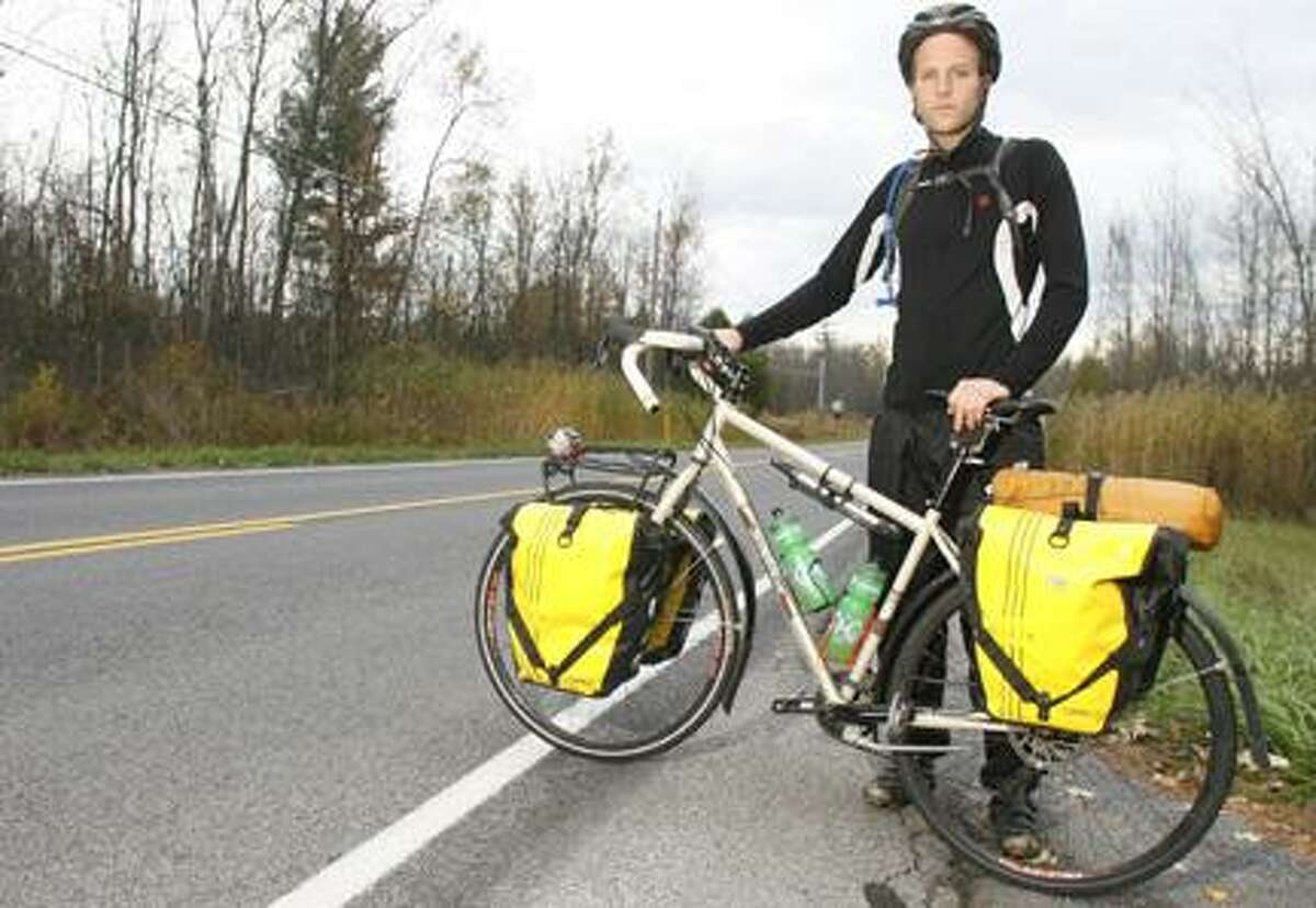 Dispatch Staff Photo by JOHN HAEGER (Twitter.com/OneidaPhoto)Patrick Armstrong poses with his bike outside of his parents' home in Whitelaw on Thursday.