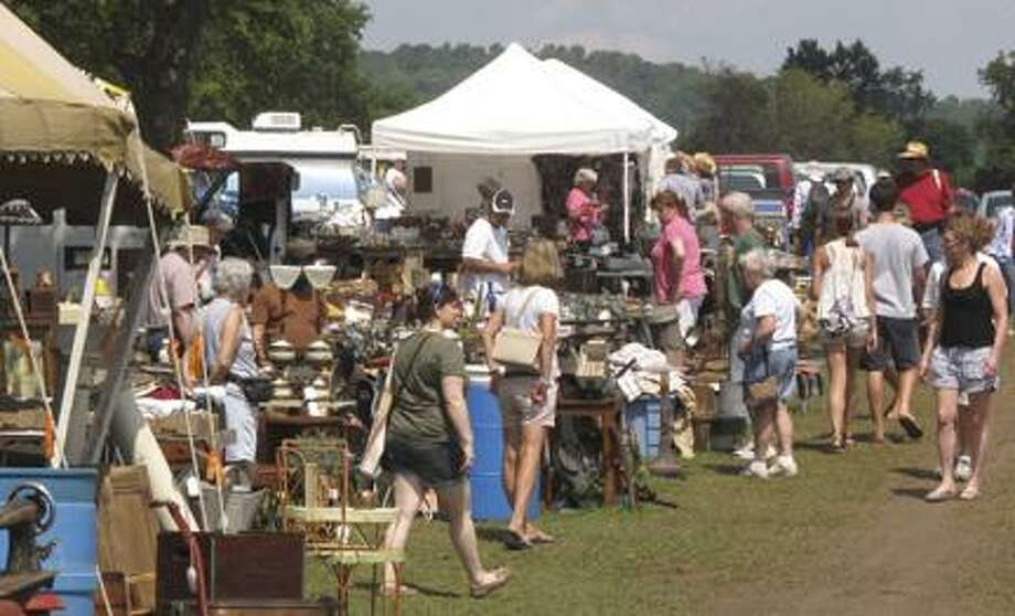 Dispatch Staff Photo by JOHN HAEGER (Twitter.com/OneidaPhoto)People look at booths filled with antiques in Bouckville during Bouckville Antique Week on Thursday, Aug. 18, 2011.