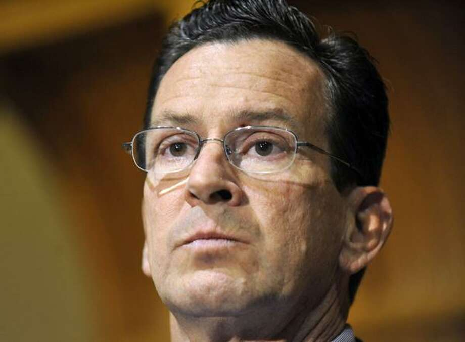In this Nov. 8, 2010 file photo, Dan Malloy, who won the Connecticut governor's race, speaks to the media at the Capitol in Hartford, Conn. (AP Photo/Jessica Hill, File)