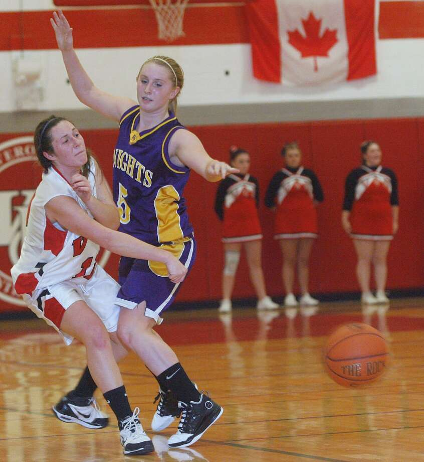 "Dispatch Staff Photo by JOHN HAEGER <a href=""http://twitter.com/oneidaphoto"">twitter.com/oneidaphoto</a> VVS Paige Zupan (10) makes a pass around Holland Patent  Alyssa Curtis (5) in the fourth quarter of the game at VVS   on Friday, Dec. 16, 2011."