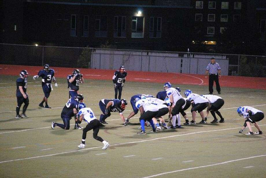 Submitted Photo The Utica Yard Dogs' quarterback Neil Stanhope leads the offense during this regular season game. The Yard Dogs play the Cortland Bulldogs in a playoff game at Vets Field in Oneida Saturday, August 20, 2011.