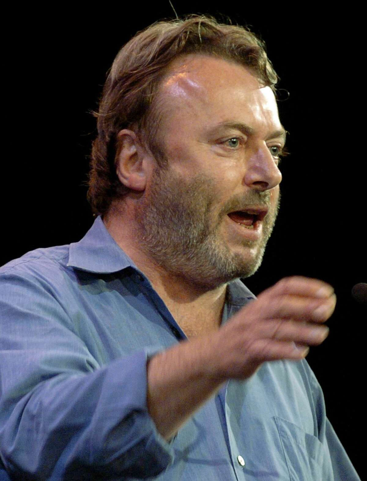 Essayist Christopher Hitchens speaks during a debate on Iraq and the foreign policies of the United States and Britain, in this Sept. 14, 2005 file photo taken in New York.Hitchens died on Thursday Dec. 15, 2011 at the age of 62 from complications of cancer of the esophagus. (AP Photo/Chad Rachman)
