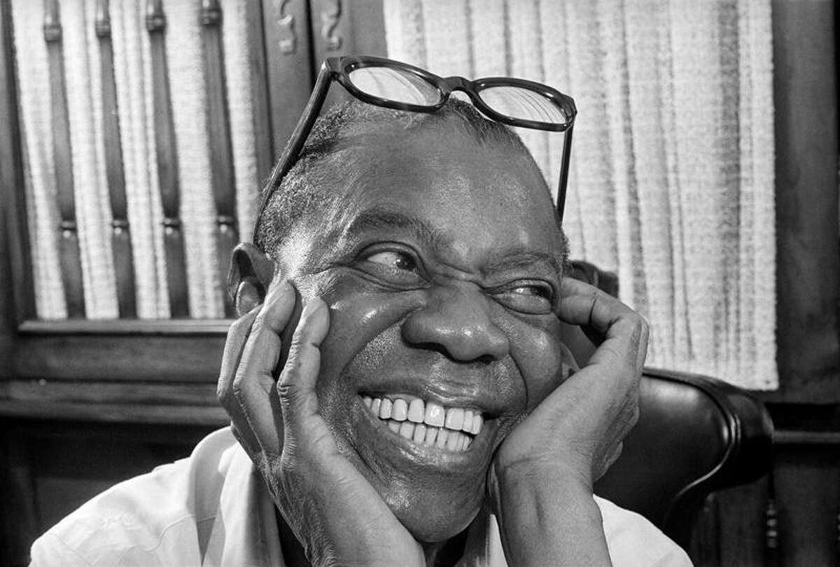 Jazz musician Louis Armstrong smiles as he recalls the old days during an interview at his home in Queens, New York, on June 10, 1970. (AP Photo/Eddie Adams)
