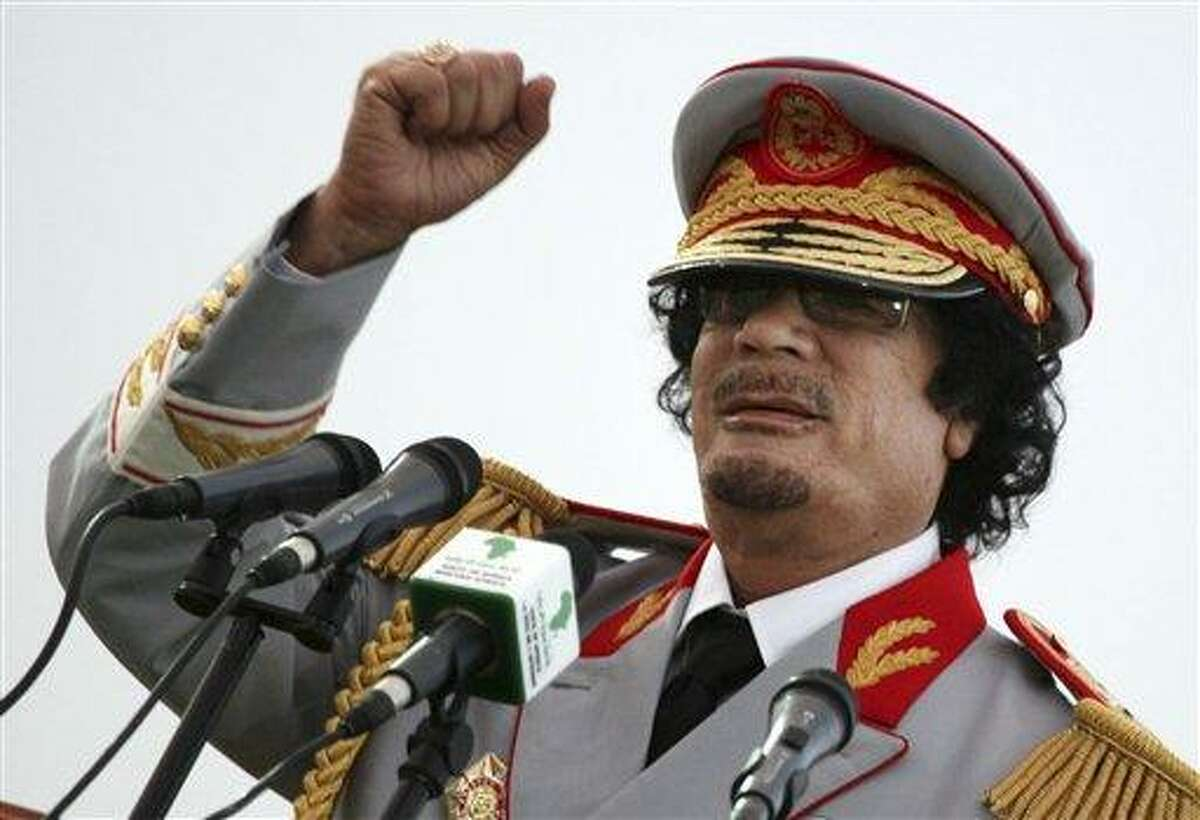 In this Saturday, June 12, 2010 file photo, Libyan leader Moammar Gadhafi talks during a ceremony to mark the 40th anniversary of the evacuation of the American military bases in the country, in Tripoli, Libya. The Associated Press is aware of reports that Moammar Gadhafi has been captured in Sirte. The chief spokesman for the revolutionary National Transitional Council Jalal el-Gallal and the council military spokesman Abdul-Rahman Busin told the AP that those reports are unconfirmed. (AP Photo/ Abdel Magid Al Fergany, File)