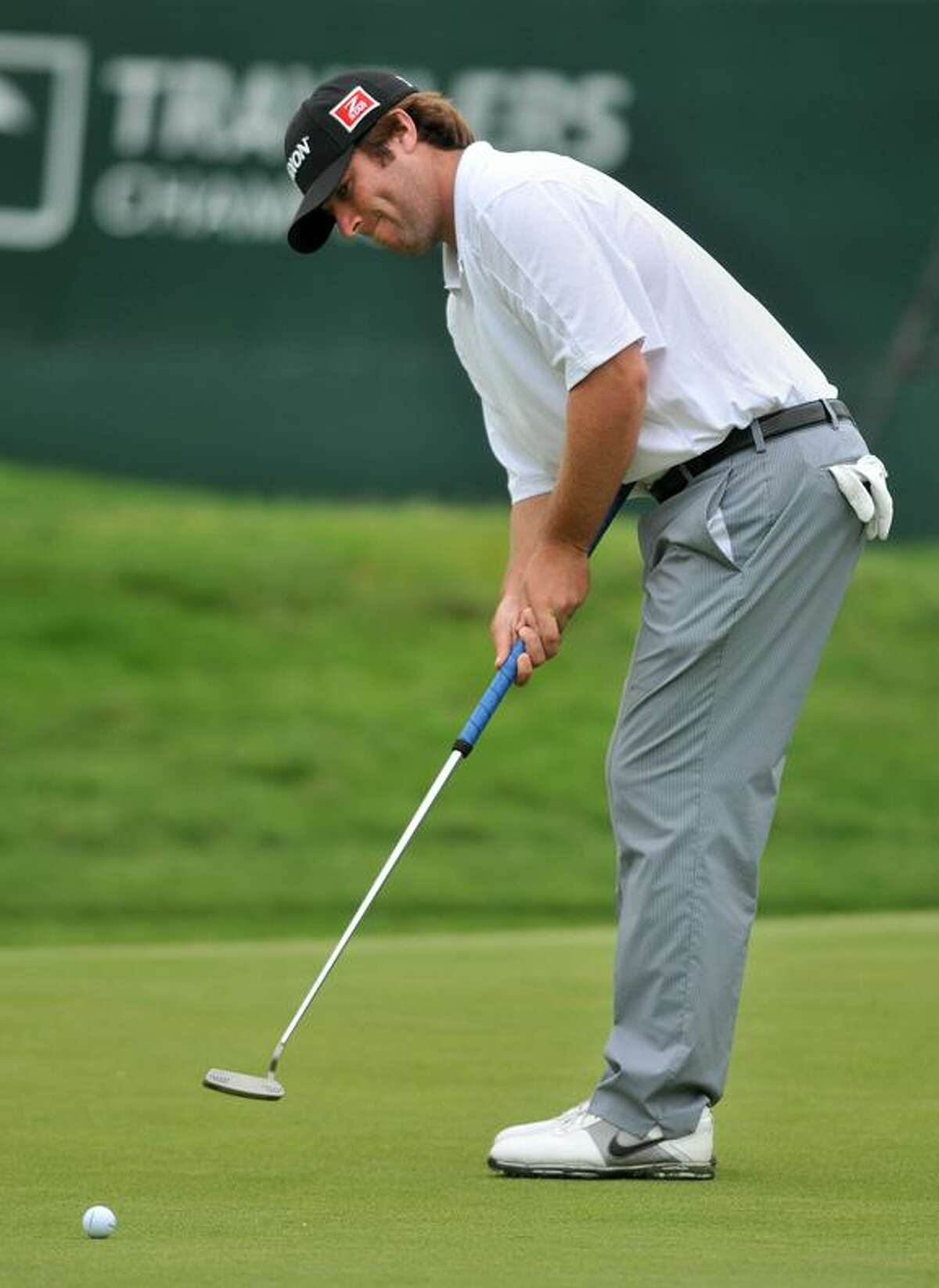 Jim Renner putts for birdie on the ninth green Friday afternoon at the Travelers Championship at TPC River Highlands in Cromwell. (Brad Horrigan/Register)