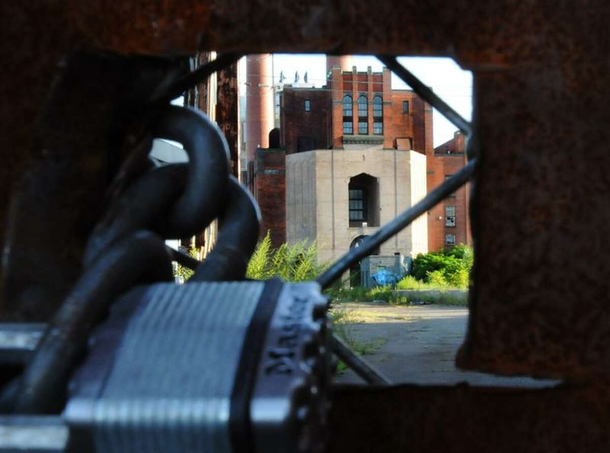 The Englsh Station power plant is seen through a locked gate off Grand Avenue in New Haven Wednesday. Melanie Stengel/Register