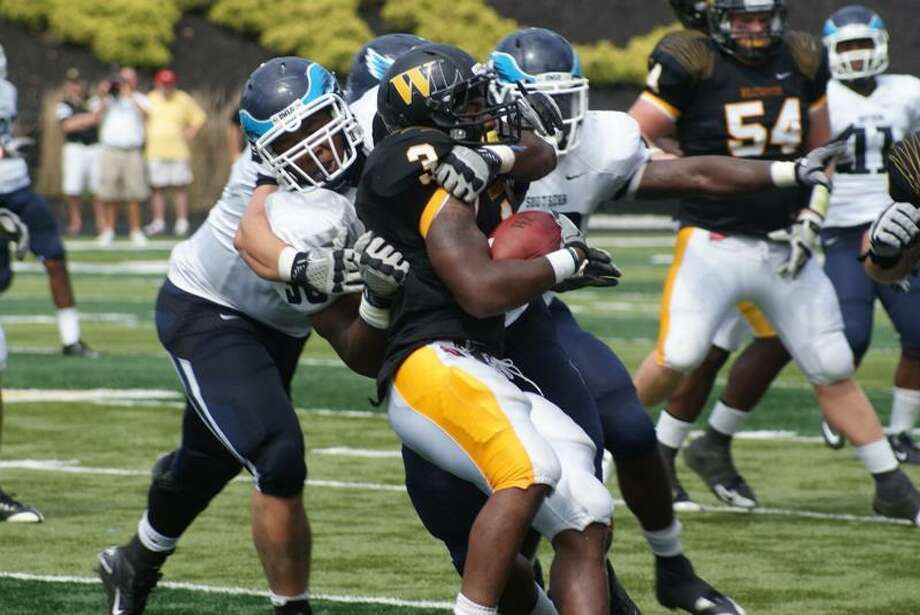 Southern Connecticut State senior defensive lineman Ikponmwosa Igbinosun, left, has the Owls headed in the right direction. (Photo courtesy of Southern Connecticut State)